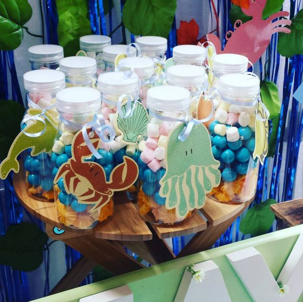 Sea themed party favours - candy in a bottle. So easy, and super cute! See the party blog at http://www.easybreezyparties.com.au/party-inspiration-and-ideas/item/124-amaya-s-under-the-sea-party.html #easybreezyparties