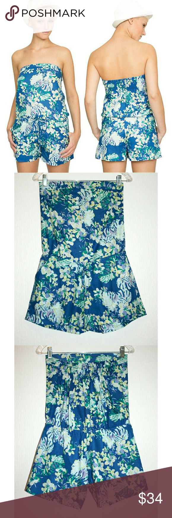 Floral & Fern Tropical Print Bandeau Playsuit NWT This tropical playsuit / romper is so stylish, cute and bright! It features an adjustable tie to cinch the waist, a bandeau neckline and pockets on the hips. The tie stings have silver metal detail on the ends. The back has a stretchy smocked/sheared panel to keep it fitted to the bust and held up nicely. The comfortable and lightweight fabric is 100% cotton, and should be washed to soften. I'm happy to provide measurements upon request…
