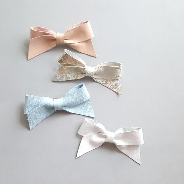 @charliecocos leather bow headband, leather bow hair clips. #charliecocos #leatherbows #leatherbowheadband #leatherhairclips #babyhairbows #babyaccessories #toddleraccessories #minifashion #ministyle #kidsaccessories #uniqueaccessories #childrensfashion #babyshowergifts #babyshowergift #babygirlbows