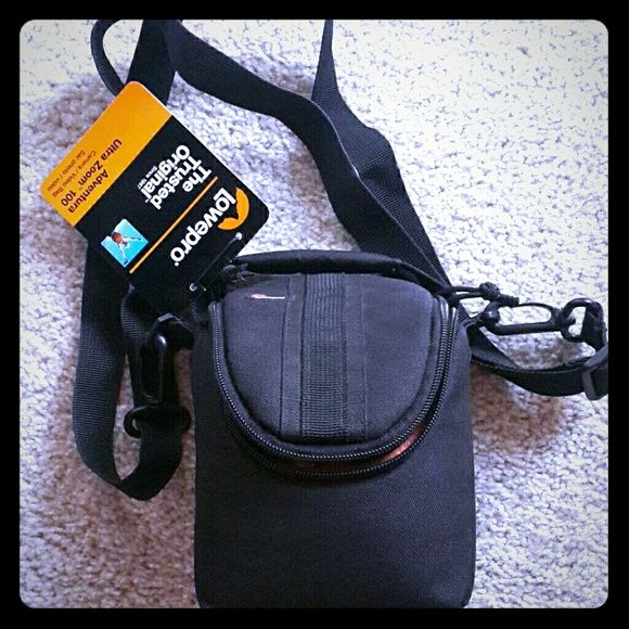 Lowepro Camera/Video Bag Fully padded. Fits most ultra zoom camera models. 2 memory card slot. Inner dimension : 6.3w x 2.8D x 3.3H. Quick grab handle. Adjustable and detachable shoulder strap. Dual zipper pulls. Exterior back pocket. Lowepro  Bags