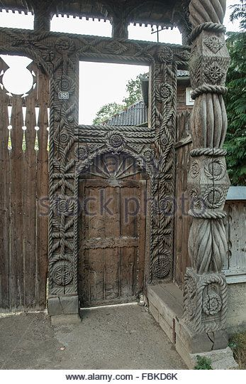 old front door carved wood in the district of Maramures, Romania - Stock Photo