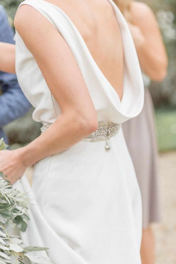 Cowl back wedding dress with silver belt | Jessica Davies Photography on @blovedblog via @aislesociety