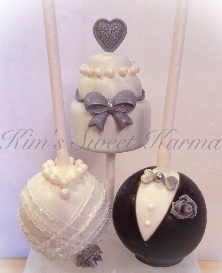 Wedding cake pops by Kim's Sweet Karma. https://m.facebook.com/Kimssweetkarma