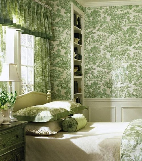 If you have to put your bed under a window, this is about the best you can do. The green toile is so calm & the painted furniture doesn't compete with it. Very attractive.