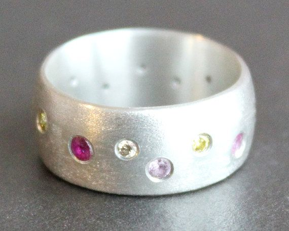 8mm Wide Silver Ring with Diamonds, Pink Sapphires and Rubies This brushed Sterling silver band with flush-set stones would make a perfect