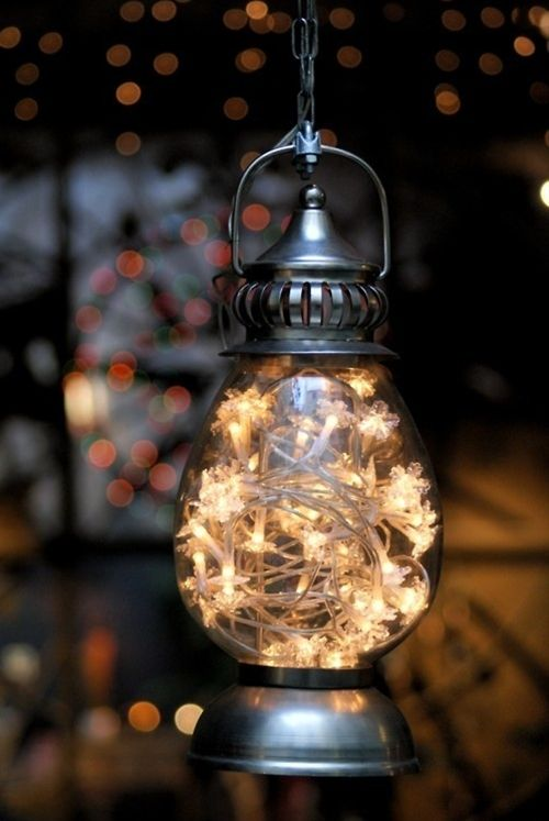 Fill any inexpensive lantern with a string of white lights and hang around your yard or in a tree.