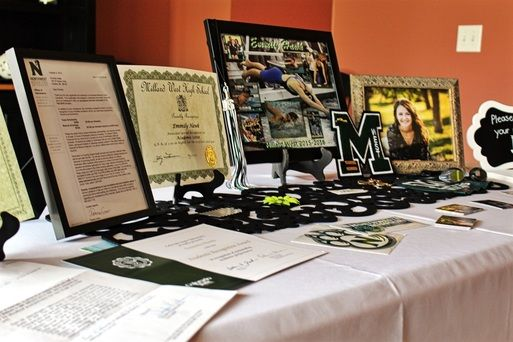 How to set up your own graduation table. Awards, medals, letters on display for a graduation party.