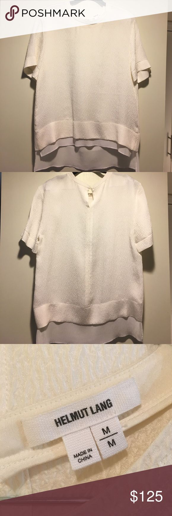 NWOT Helmut Lang blouse NWOT beautiful white Helmut Lang silk blouse. Love this top but selling because it's too big for me (bought a medium by mistake). Took the tags off but never wore it. The shell is 100% silk and the bottom layer is a silk/viscose blend. Helmut Lang Tops Blouses