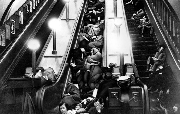 Londoners sleep on stopped escalators of a tube station for safety and shelter during heavy bombing by the Germans in London, England, in 1940 during the blitz in World War II. (AP Photo)