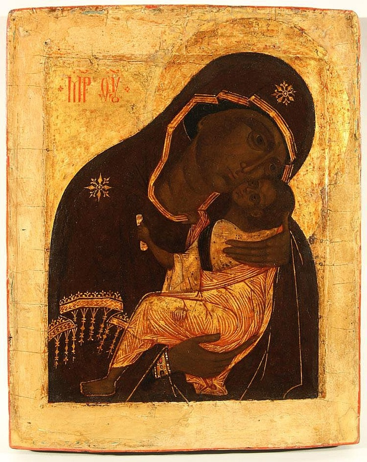 A RUSSIAN ICON OF THE MOTHER OF GOD OF TENDER EMOTION (UMILENIE), CIRCA 1600, Egg tempera, gold leaf, and gesso on wood panel, with a raised border kovcheg.