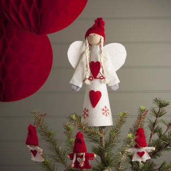 nordic tree topper angel or santa by the christmas home | notonthehighstreet.com