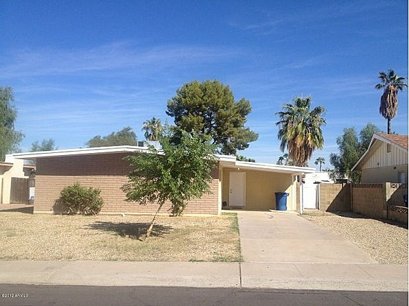 This awesome Tempe home has been completely remodeled top to bottom. It's contemporary finished cement floors,fireplace in the family room, brick patio, and wet bar in a huge bonus game room, makes this the perfect home for family and friends. Close to freeways, ASU,shopping, great Tempe restaurants and much more! #zillow