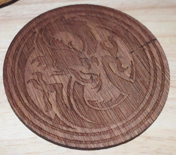 Fantasy Dragon Coasters  These stunning wooden dragon coasters are available in the set of 2 with a finish of your choosing. There are engraved on 4mm plywood and stained to ensure long lasting and hard wearing.  These make the ideal gift for any dragon lover, dnd/pathfinder player and would