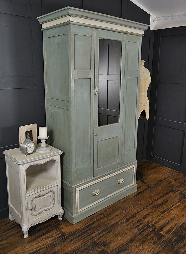 This rustic gentleman's wardrobe with mirror and drawer has rustic charm in…