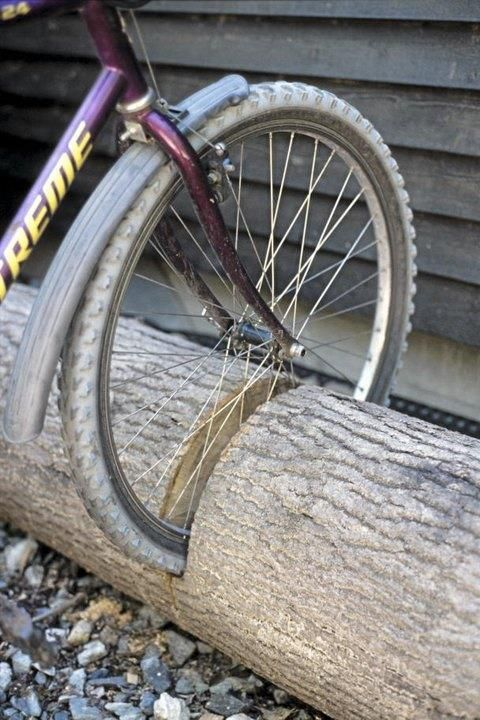 Need a bike rack? Got a log? Walla you have a bike rack. Just use a chain saw and cut into the log the width of the tire and down a bit, say 2-3 inches from the bottom and insert your bike.