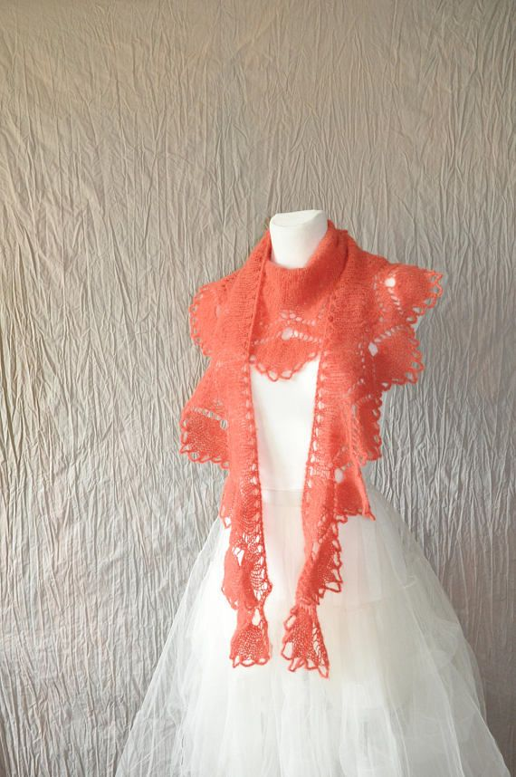 This crescent shape lace knit scarf is made of soft yarn (blend of alpaca and silk). Scarf is adorned with beautiful edge. Its soft, delicate and very light (weight approx 50g). This Shawl has an interesting color something between orange and red (nectarine, grenadine) Because of different monitors and screen resolutions, color may look different on the screen than reality.  Measurement: length: approx.174 cm [68.5] width (at its widest point): approx. 27 cm [10.6]  Hand wash in lukewarm…