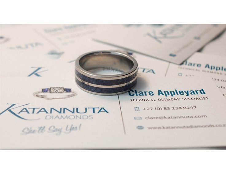 Our unique Njenjere titanium ring range is guaranteed to turn heads wherever this jewellery is worn. If blue is your colour, this ring is for you. An 8mm wide flat titanium ring is set with 2 sets of crushed blue gem inlays, each 2.5mm wide. Manufactured to order, this ring is available up to size Z +6 and is priced from R1,900, depending on ring size. Featuring crushed gemstones of your choice, the gem inlay can feature one colour gemstones, or a coloured mixture of gemstones.