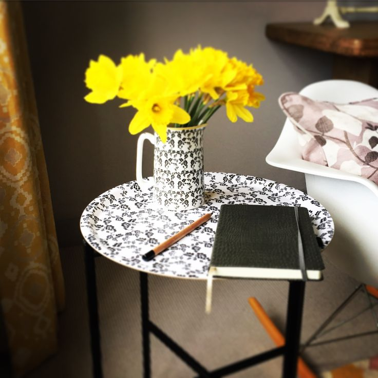 """The practical fold-away steel black stand £30 , converts our Round trays £25 into a side table for use; on a balcony, outside on the patio, as a bedside table, a side table etc. The options are endless.  Stand size 38cm x H:53cm Round trays sold separately £25. Feature original """"The Humble Cut"""" potato printed artwork. """"Vine"""" jug  £18 #traytable #tray #sidetable"""