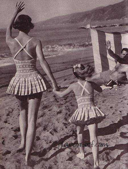 a day at the beach in 1959….love the mother - daughter suits!