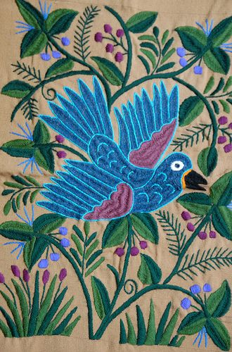 This colorful blue bird was embroidered by Pascuala Hernandez of Zinacantan Chiapas Mexico on cloth that she had woven on her backstrap loom - We love the color, patterns, variety and workmanship that go into the beautiful hand made textiles of Mexico - to see more visit www.mainlymexican... #Mexico #Mexican #textile #woven
