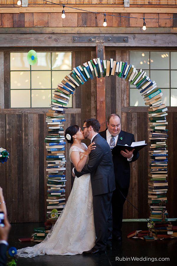 A wedding under a book arch. Photographed by Rubin Weddings. Sodo Park wedding- Cindy and Sam