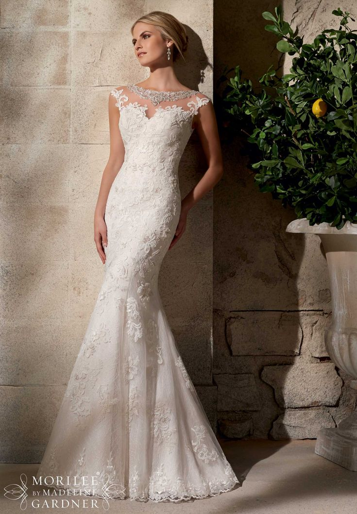 Wedding Gowns by Morilee featuring Embroidered Appliques on Net Over Chantilly Lace with Crystal Beading- Available in Three Lengths: 55 inches, 58 inches, 61 inches Available in White/Silver, Ivory/Silver, Cafe/Silver