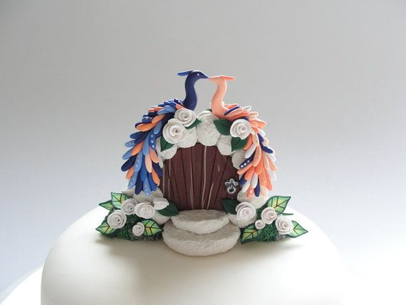 Navy blue and peach peacock themed wedding cake topper handmade from polymer clay