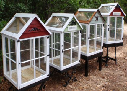 Greenhouses from old wood windows and industrial scrap material
