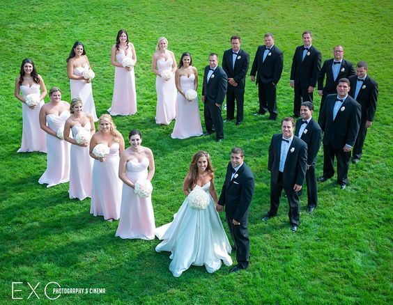 Pink bridesmaids attire from Bridal Reflections photographed by www.exophotogra…