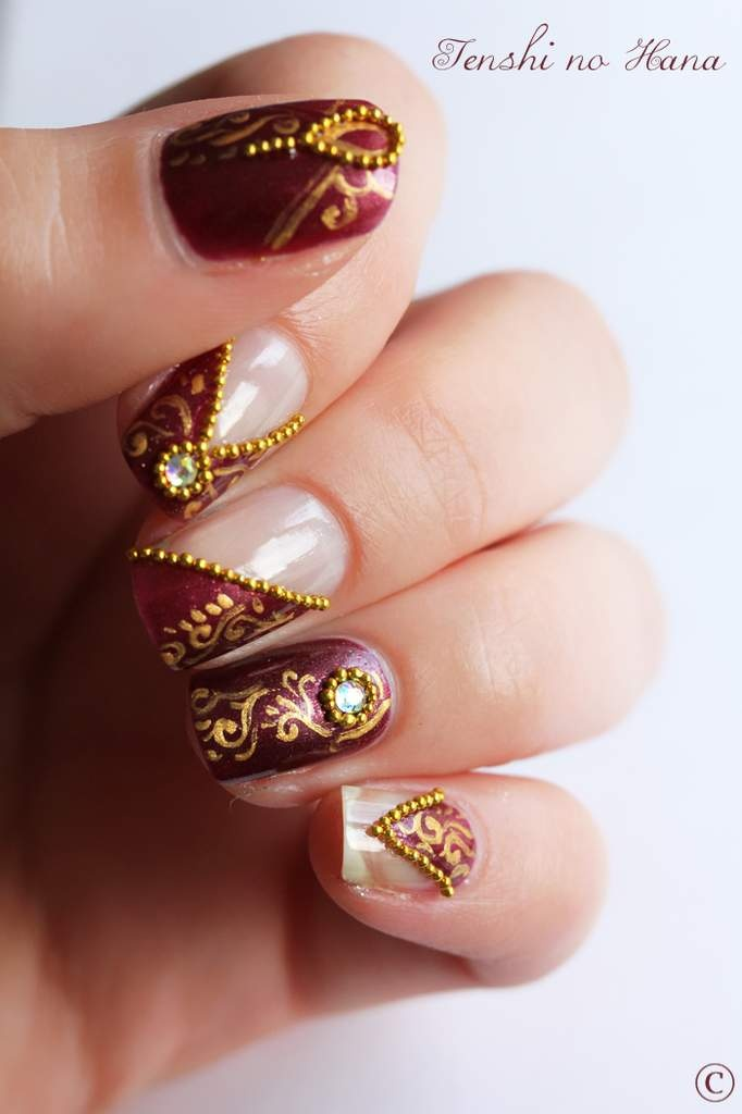 Omg Indian design nails. these would totally go with indian outfits.