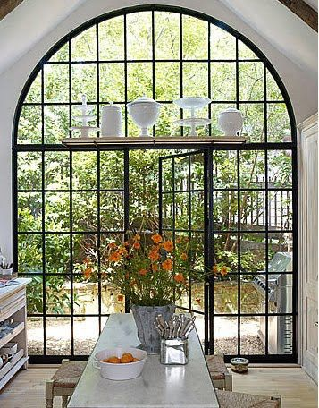 I love this beautiful window wall in this kitchen with the door to the patio outside. However, the view outside the window wall is lackluster and needs a major overhaul to be up to scale with the grandness of that window wall.