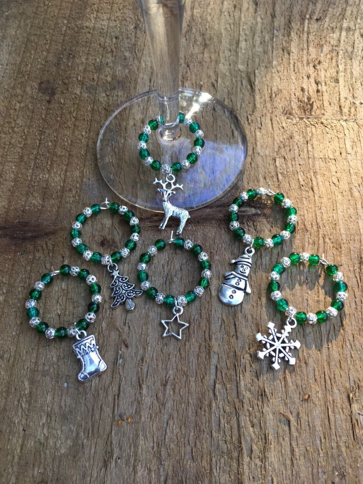 A personal favourite from my Etsy shop https://www.etsy.com/uk/listing/489210081/wine-glass-charms-green-christmas-wine
