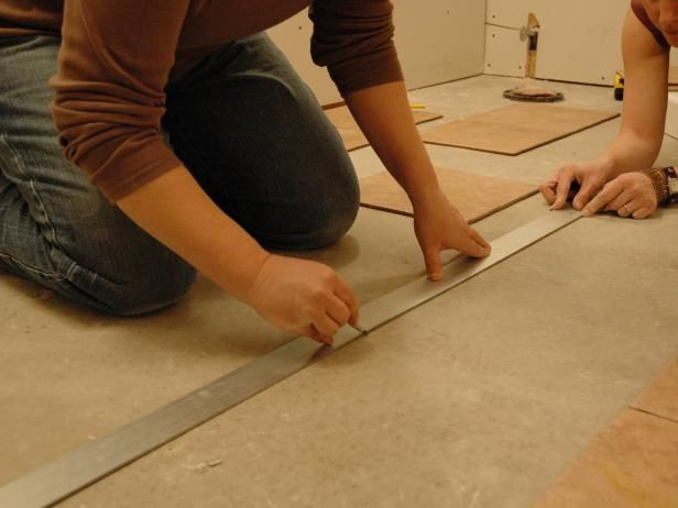 DIYNetwork.com has step-by-step instructions on how to install ceramic floor tiles in a bathroom.