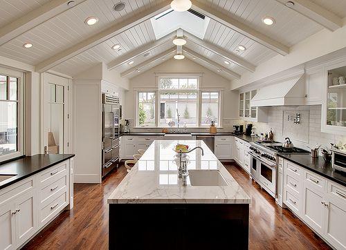 Huge kitchen, multiple sinks. Breville toaster convection oven in the corner?