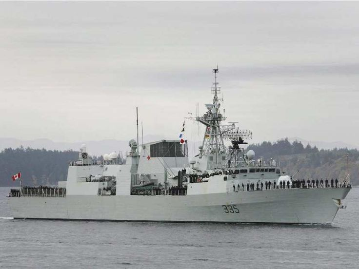 HMCS Calgary returns to Victoria on Oct. 24, 2008. The former second-in-command of the Canadian warship has been charged with disobeying orders and drunkenness.
