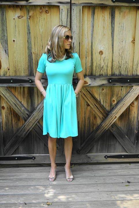LuLaRoe Amelia dress. Back exposed zipper, pockets, covers it all, classy…
