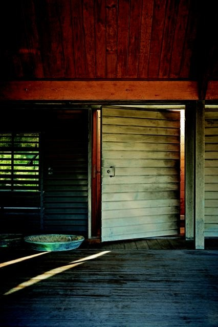 The large pivoting door, in Glenn Murcutt's Kempsey House, divides the north-western veranda and the bathroom/bedroom area. When closed it appears part of the wall.