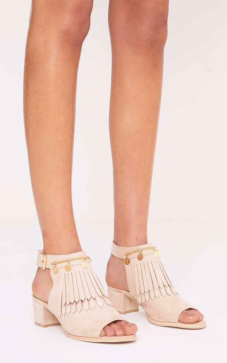 Beige Coin Ankle BootsWe are loving these super cute ankle boots! Featuring an open back cut, tas...