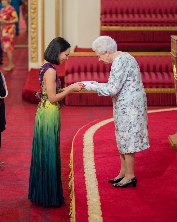 Chantelle de Abreu in her Hendrik Vermeulen receiving her Queen's Young Leaders award from the Queen of England