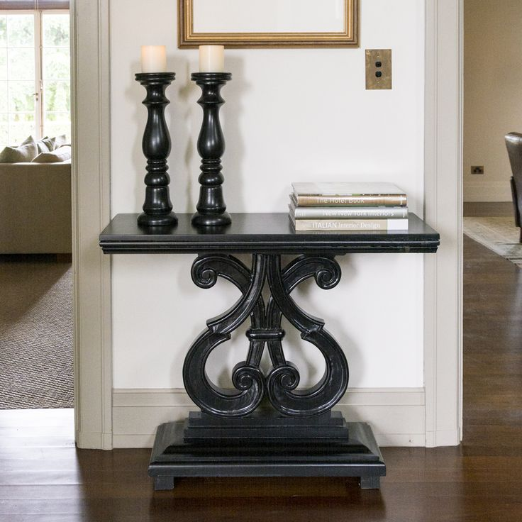 Create a design statement for your room with our Baroque Console. The bold scroll work and sophisticated black gloss finish provide a modernizing element for contemporary, classic French or eclectic furniture styles.