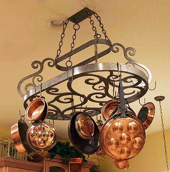 I really love pot rack holders for the kitchen; keeps pots out of the way but easy to reach!