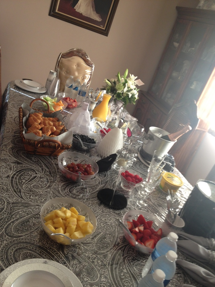Brunch table, getting ready! My mom kept within the black & white theme for the decor. She had champagne, OJ, cranberry juice, fresh cut fruit garnish and salad, croissants, Danish, yogurts and coffee!