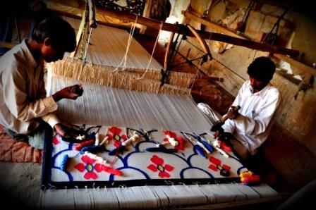 Nemaram and his son working on the loom in Jodhpur, Rajasthan