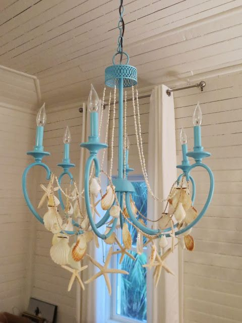 A DIY shell garland chandelier. Make this with collected shells (not bought in stores = harvested alive).
