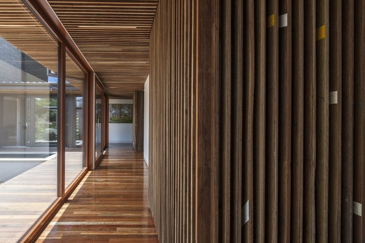 Spotted Gum flooring salvaged from a basketball stadium used as wall cladding with the line markings remaining as a feature
