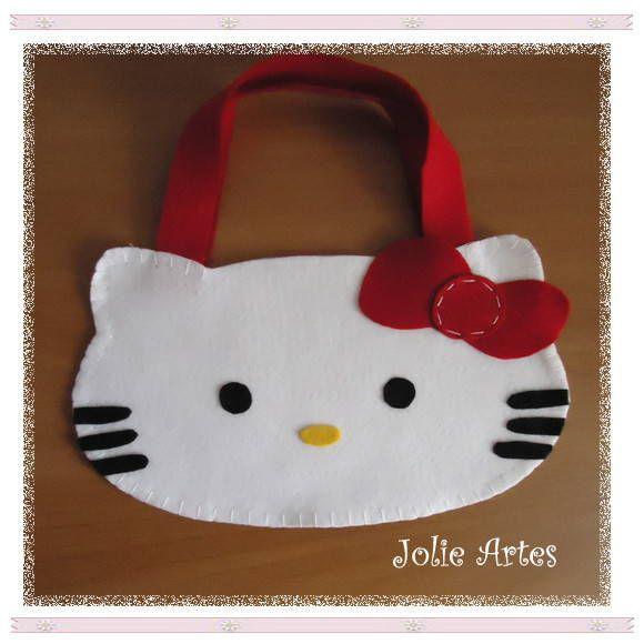 Sacolinha surpresa da Hello Kitty, confeccionada em feltro.  Linda opção para festa de aniversário.  -------------------------------------------------------------------------------- Fazemos diversos personagens e temas (consulte-nos). --------------------------------------------------------------------------------  Pedido Mínimo: 5 unidades  Acompanha Tag personalizada (nome + data + frase).  Qualquer dúvida fique a vontade pra deixar um recadinho ou encaminhar um e-mail para…