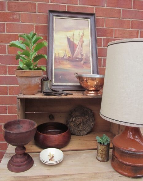 Vintage styling: Retro lamp, vintage sailing boat painting, vintage wooden bowls and plates, copper colander.  Items fo sale @ https://www.facebook.com/pages/Rubys-and-Pearls/744861835533003