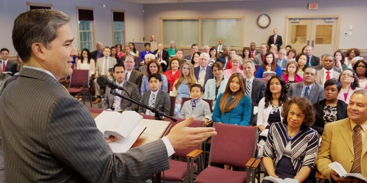 A congregation meeting of Jehovah's Witnesses. What do they belive?