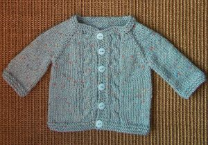 Max Knit Baby Cardigan - If you've ever wanted to learn how to knit a sweater but are intimidated by the scale of the project, a baby version is a great way to start. Get the free knitting pattern here.