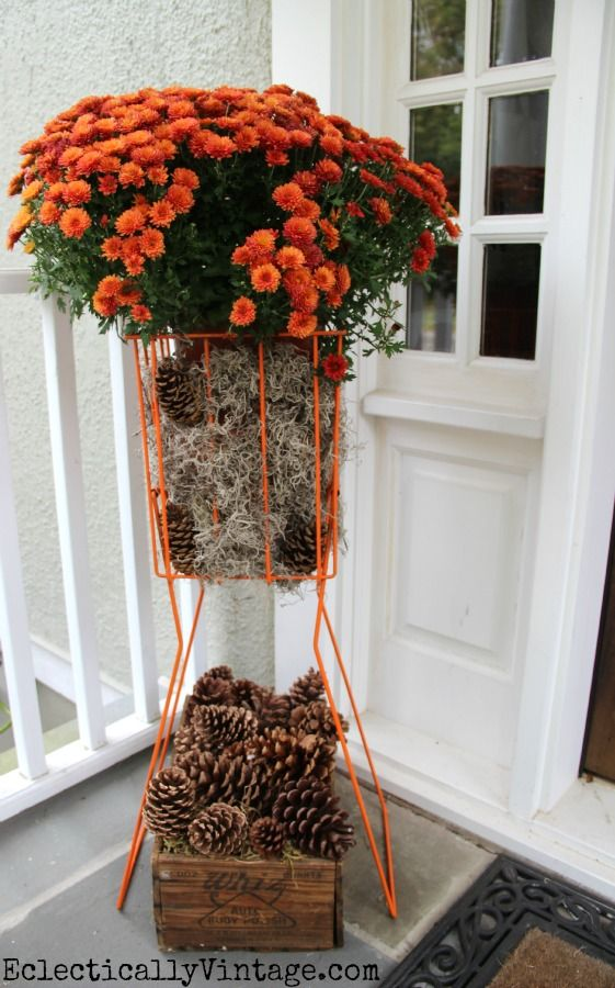 Fabulous idea - a tennis ball hopper #planter!  See more of this #fall porch eclecticallyvintage.com